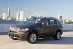 2013 BMW X5 xDrive50i in Sparkling Bronze Metallic - Driving Front Left Three-quarter View