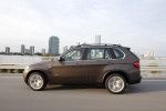 2013 BMW X5 xDrive50i in Sparkling Bronze Metallic - Driving Left Side View