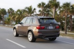 2013 BMW X5 xDrive50i in Sparkling Bronze Metallic - Driving Rear Left Three-quarter View
