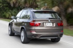 2013 BMW X5 xDrive50i in Sparkling Bronze Metallic - Driving Rear Left View