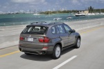2013 BMW X5 xDrive35i in Sparkling Bronze Metallic - Driving Rear Right View