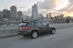 2013 BMW X5 xDrive35i in Sparkling Bronze Metallic - Driving Rear Right Three-quarter View