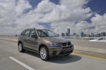 2013 BMW X5 xDrive35i in Sparkling Bronze Metallic - Driving Front Right View