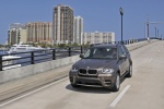 2013 BMW X5 xDrive35i in Sparkling Bronze Metallic - Driving Front Left View