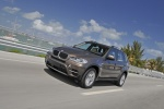 2013 BMW X5 xDrive35i in Sparkling Bronze Metallic - Driving Front Left Three-quarter View