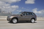 2013 BMW X5 xDrive35i in Sparkling Bronze Metallic - Driving Left Side View