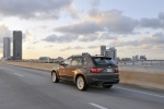 2013 BMW X5 xDrive35i in Sparkling Bronze Metallic - Driving Rear Left Three-quarter View