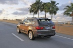 2013 BMW X5 xDrive35i in Sparkling Bronze Metallic - Driving Rear Left View