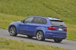 2013 BMW X5 M in Monte Carlo Blue Metallic - Driving Rear Left Three-quarter View