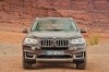 2014 BMW X5 xDrive50i in Sparkling Brown Metallic from a frontal view