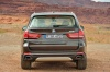 2014 BMW X5 xDrive50i in Sparkling Brown Metallic from a rear view
