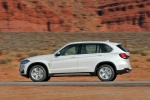 2014 BMW X5 xDrive35d in Alpine White - Driving Left Side View