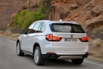 2014 BMW X5 xDrive35d in Alpine White - Driving Rear Left View