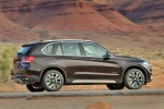 2014 BMW X5 xDrive50i in Sparkling Brown Metallic - Driving Right Side View