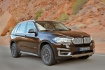 2014 BMW X5 xDrive50i in Sparkling Brown Metallic - Driving Front Right Three-quarter View