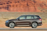 2014 BMW X5 xDrive50i in Sparkling Brown Metallic - Driving Left Side View