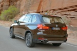 2014 BMW X5 xDrive50i in Sparkling Brown Metallic - Driving Rear Left Three-quarter View
