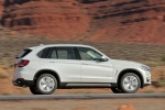 2014 BMW X5 xDrive35d in Alpine White - Driving Right Side View