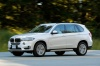 Driving 2017 BMW X5 xDrive50i in Alpine White from a front left three-quarter view