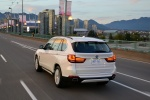 2017 BMW X5 xDrive50i in Alpine White - Driving Rear Left View