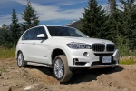 2017 BMW X5 xDrive50i in Alpine White - Driving Front Right Three-quarter View