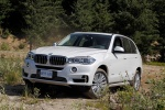 2017 BMW X5 xDrive50i in Alpine White - Driving Front Left Three-quarter View