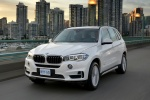 2017 BMW X5 xDrive50i in Alpine White - Driving Front Left View