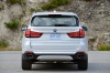 2018 BMW X5 xDrive50i in Alpine White from a rear view