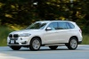 Driving 2018 BMW X5 xDrive50i in Alpine White from a front left three-quarter view