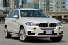2018 BMW X5 xDrive50i in Alpine White from a front right view