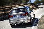 Picture of a driving 2018 BMW X5 M in Donington Gray Metallic from a rear right perspective