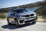 Picture of a driving 2018 BMW X5 M in Donington Gray Metallic from a front right three-quarter perspective