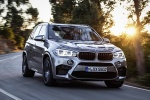 Picture of a driving 2018 BMW X5 M in Donington Gray Metallic from a front right perspective