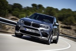 Picture of a driving 2018 BMW X5 M in Donington Gray Metallic from a front left perspective