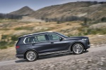 Picture of a driving 2019 BMW X7 xDrive40i AWD in Arctic Gray Metallic from a right side perspective