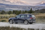 Picture of a driving 2019 BMW X7 xDrive40i AWD in Arctic Gray Metallic from a rear left three-quarter perspective