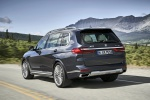 Picture of a driving 2019 BMW X7 xDrive40i AWD in Arctic Gray Metallic from a rear left perspective