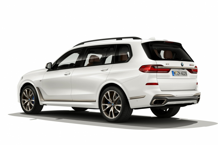 2019 BMW X7 M50i AWD in Alpine White from a rear left three-quarter view