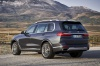 2019 BMW X7 xDrive40i AWD in Arctic Gray Metallic from a rear left three-quarter view