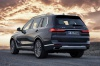 2019 BMW X7 xDrive40i AWD in Arctic Gray Metallic from a rear left view