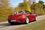2011 BMW Z4 sdrive35is in Crimson Red - Driving Rear Right Three-quarter View