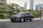 Picture of a driving 2019 Buick Enclave Avenir in Dark Slate Metallic from a front left three-quarter perspective