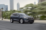 Picture of a driving 2019 Buick Enclave Avenir in Dark Slate Metallic from a front right three-quarter perspective