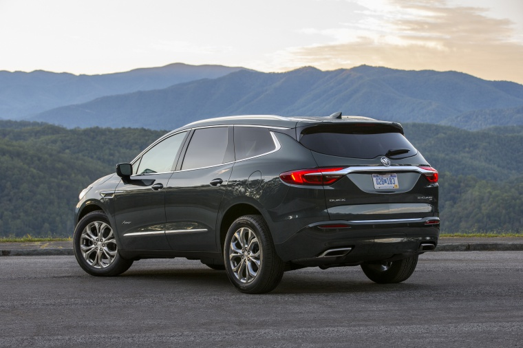Picture of a 2020 Buick Enclave Avenir in Dark Slate Metallic from a rear left three-quarter perspective