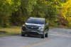 Picture of a driving 2020 Buick Enclave Avenir in Dark Slate Metallic from a front left perspective
