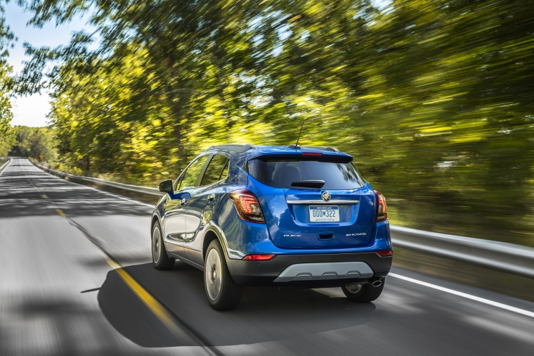 Driving 2018 Buick Encore in Coastal Blue Metallic from a rear left view