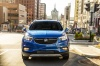 Driving 2018 Buick Encore in Coastal Blue Metallic from a frontal view