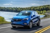 Driving 2018 Buick Encore in Coastal Blue Metallic from a front left view