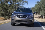 Picture of a driving 2017 Buick Envision AWD in Bronze Alloy Metallic from a frontal perspective