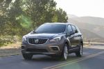 Picture of a driving 2017 Buick Envision AWD in Bronze Alloy Metallic from a front left perspective